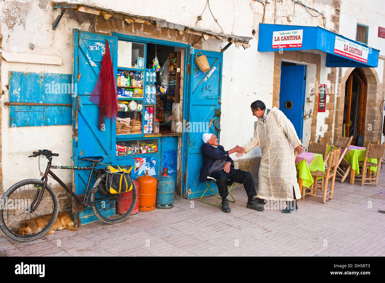 Arab men greeting other stock photos arab men greeting other stock two men greeting each other in front of a small shop essaouira morocco m4hsunfo