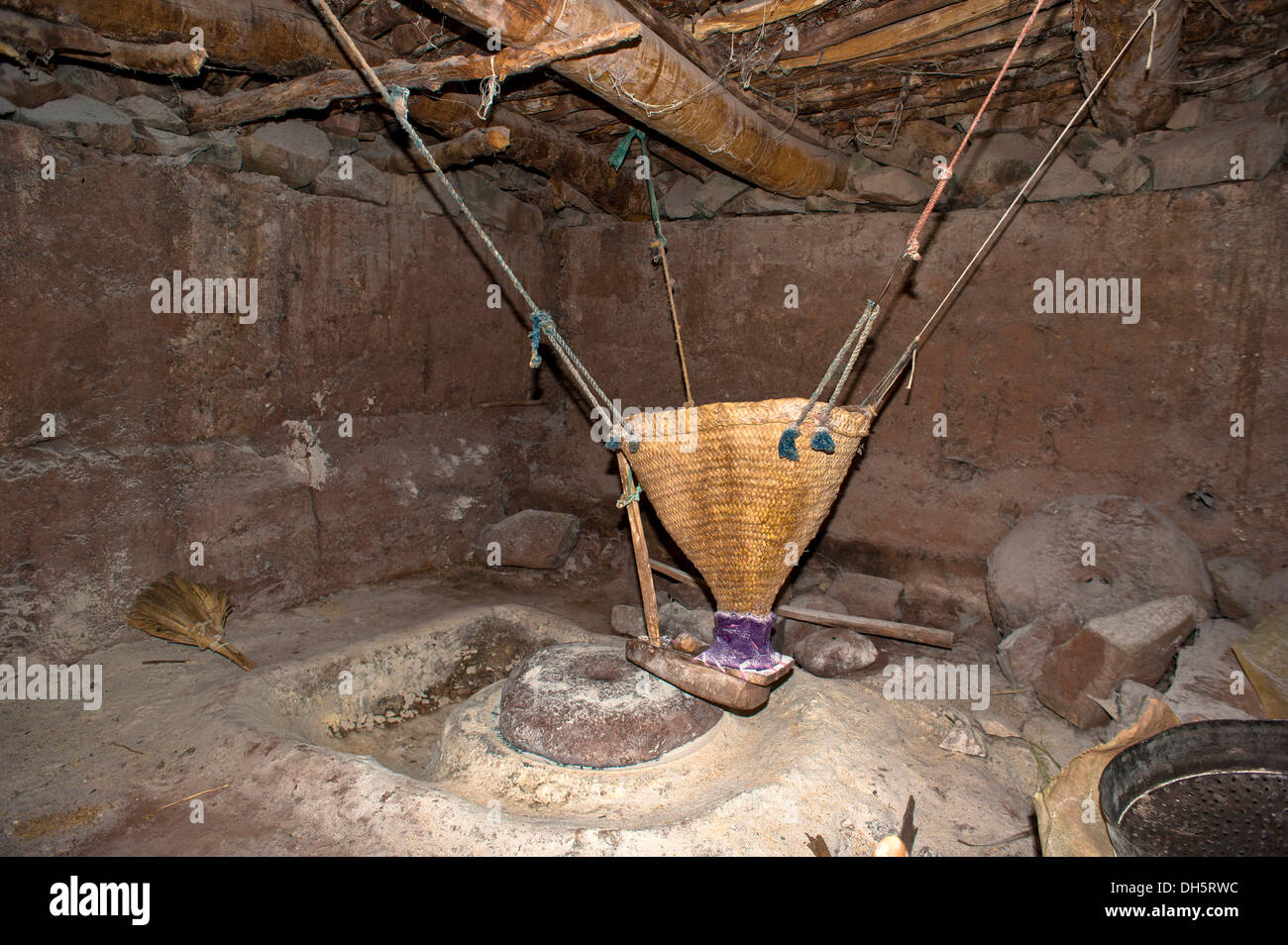 Old grain mill and a grinding stone on a stream, Ait Bouguemez, High Atlas, Morocco, Africa - Stock Image