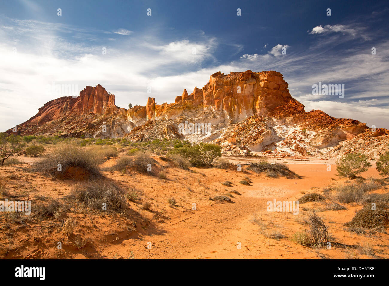 Spectacular Australian outback desert landscape with golden rocky outcrop at Rainbow Valley central Australia NT - Stock Image