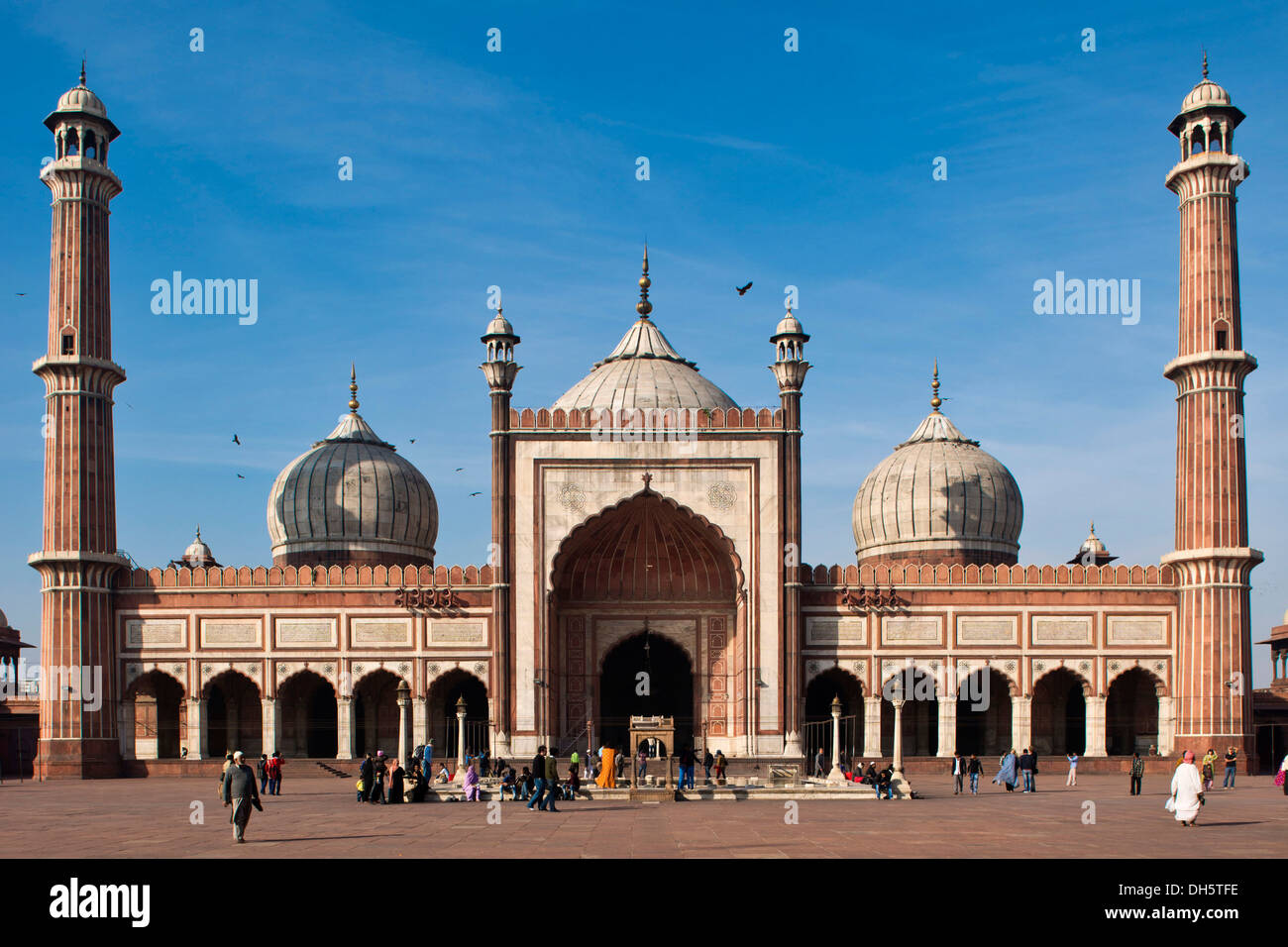 Islamic Jama Masjid Mosque, Masjid-i Jahān-Numā, with domes and minarets, largest mosque in India, Delhi, India - Stock Image