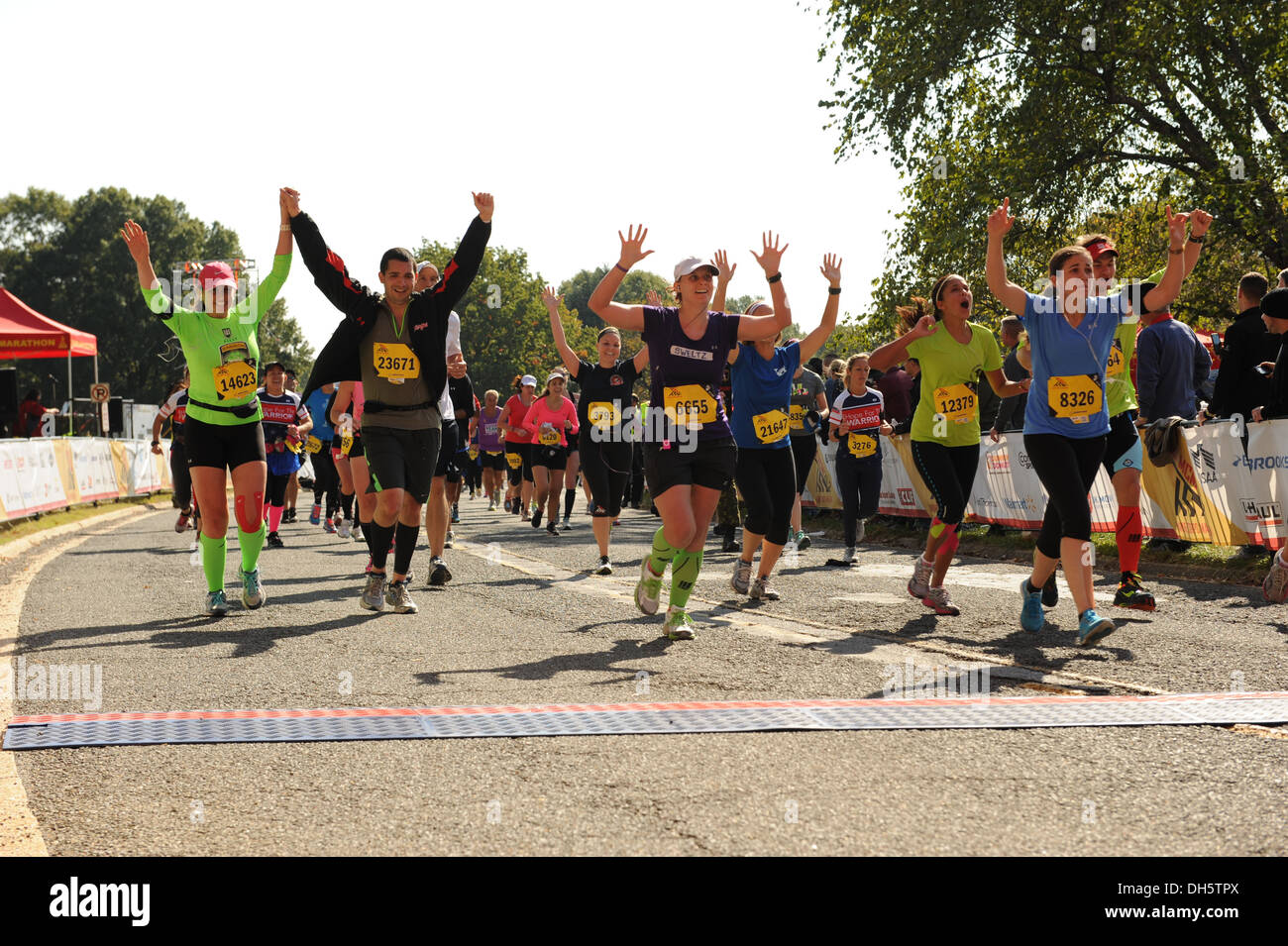 Runners celebrate as they cross the finish line at the end of the 38th Annual Marine Corps Marathon, Washington, D.C., Oct. 27, - Stock Image