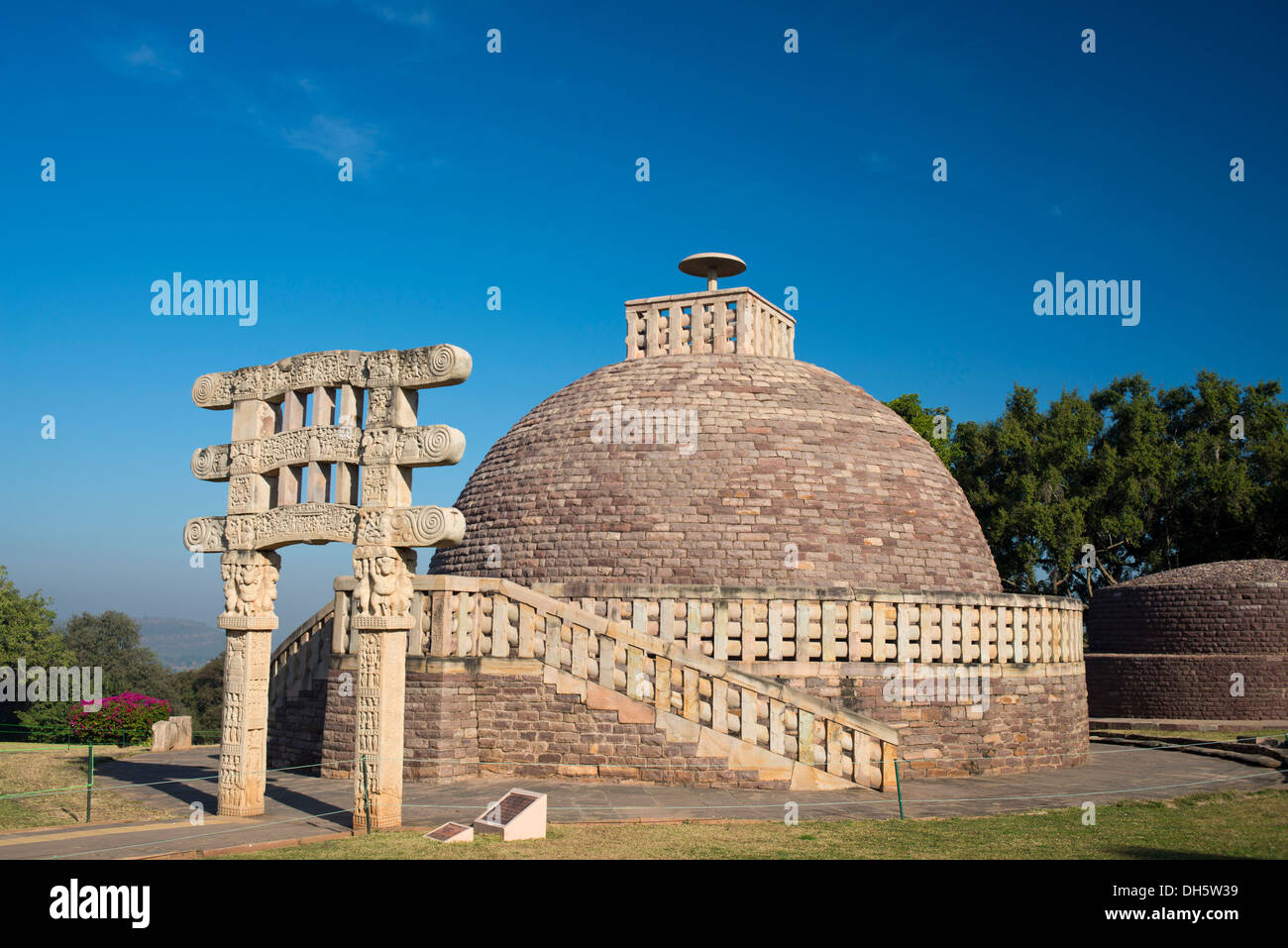 Toran or sacred gateway with stone reliefs at the Buddhist stupa, Stupa No. 1, a large stupa from 2nd century BC, UNESCO World - Stock Image