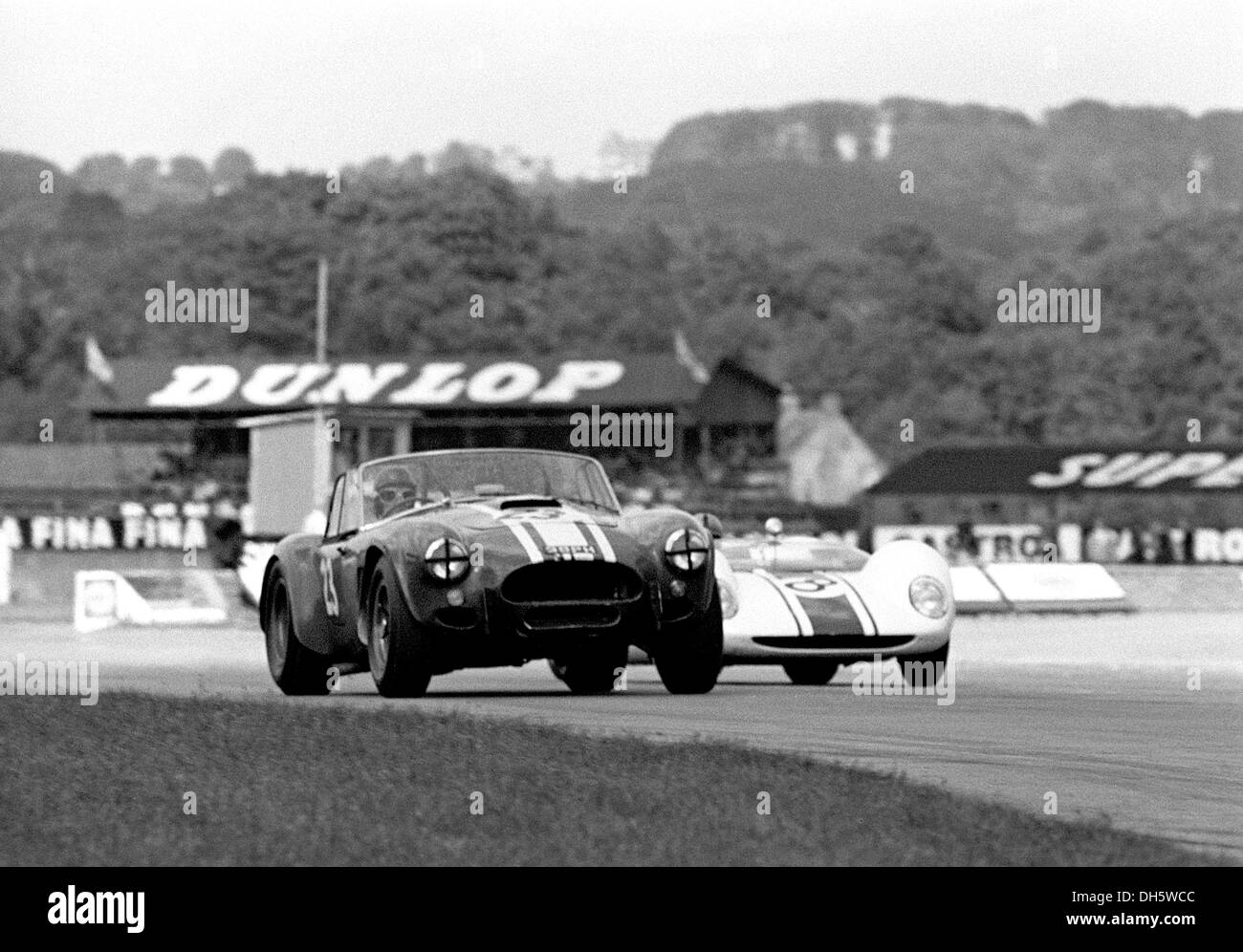 No23 Jack Sears' Willment Cobra, No8 Denny Hulme's Brabham BT8 Climax in the Goodwood RAC TT, England 29th August 1964. - Stock Image