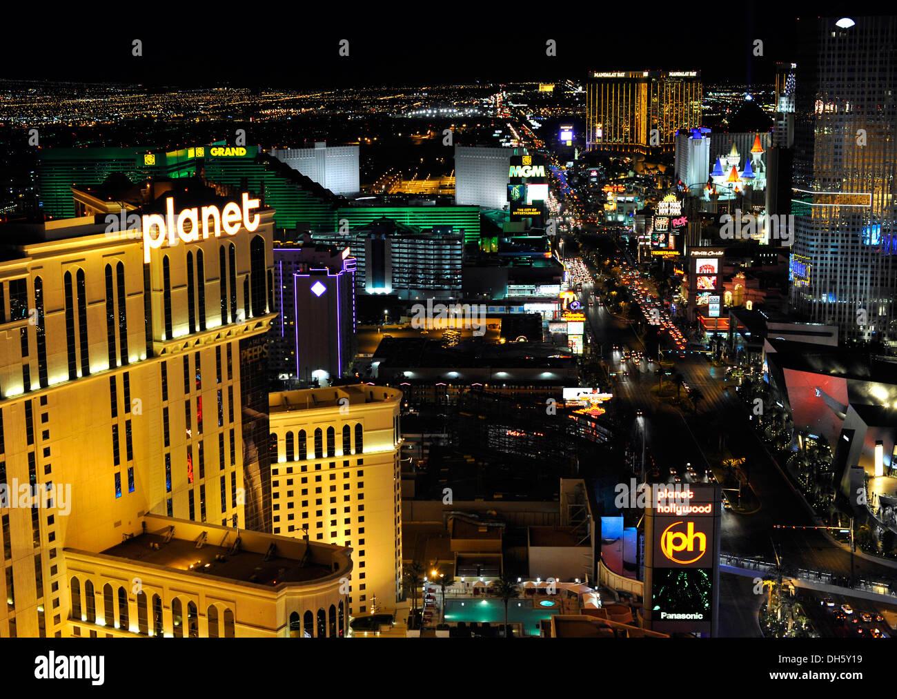Night scene, The Strip, Planet Hollywood luxury hotel, MGM Grand, New York, Mandalay Bay, Excalibur, Vegas, Nevada - Stock Image