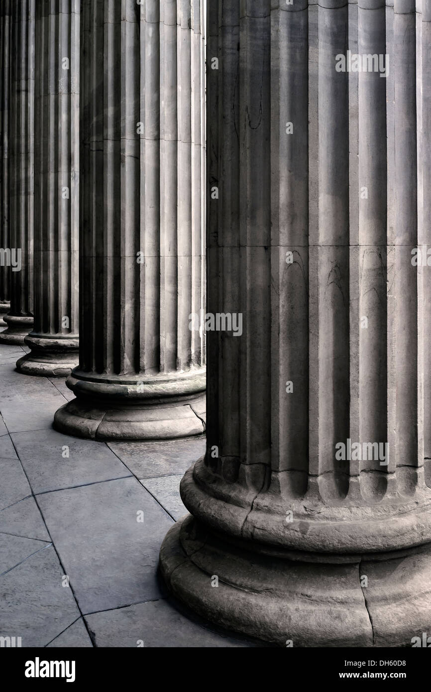 Fluted concrete pillars at the entrance to gallery of Modern Art, Queen Street, Glasgow, Scotland, UK - Stock Image