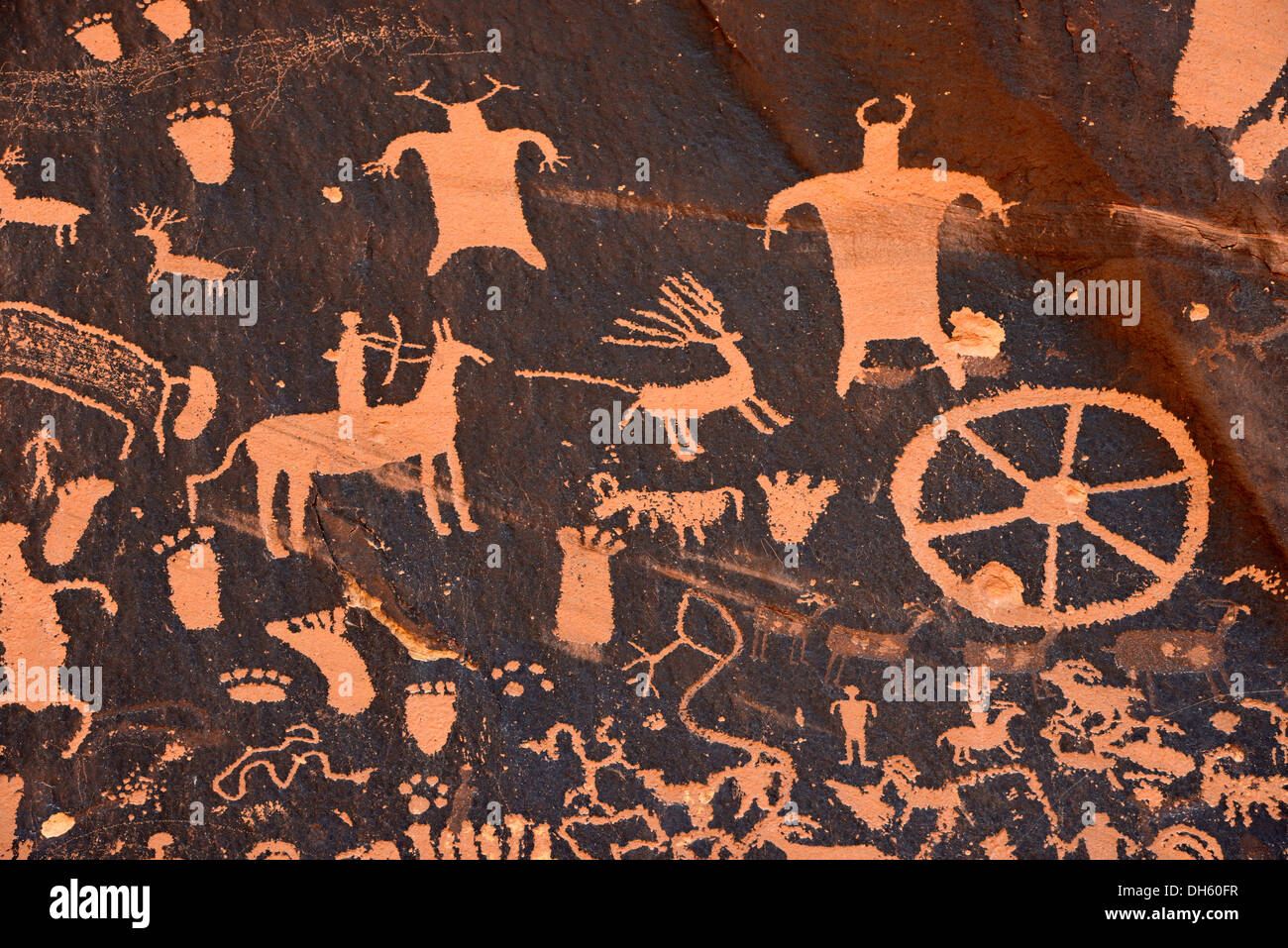 Hunting scene carved into sandstone, petroglyphs, representation of Fremont, Anasazi, Navajo and Anglo-Saxon cultures, Stock Photo