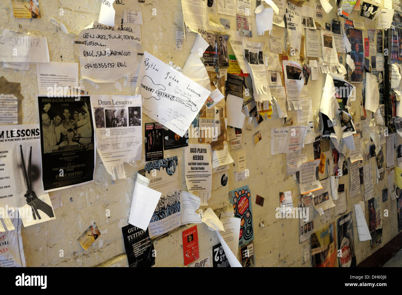 London, England, UK. Posters and adverts stuck to a wall (legible contact details digitally changed or removed) - Stock Image