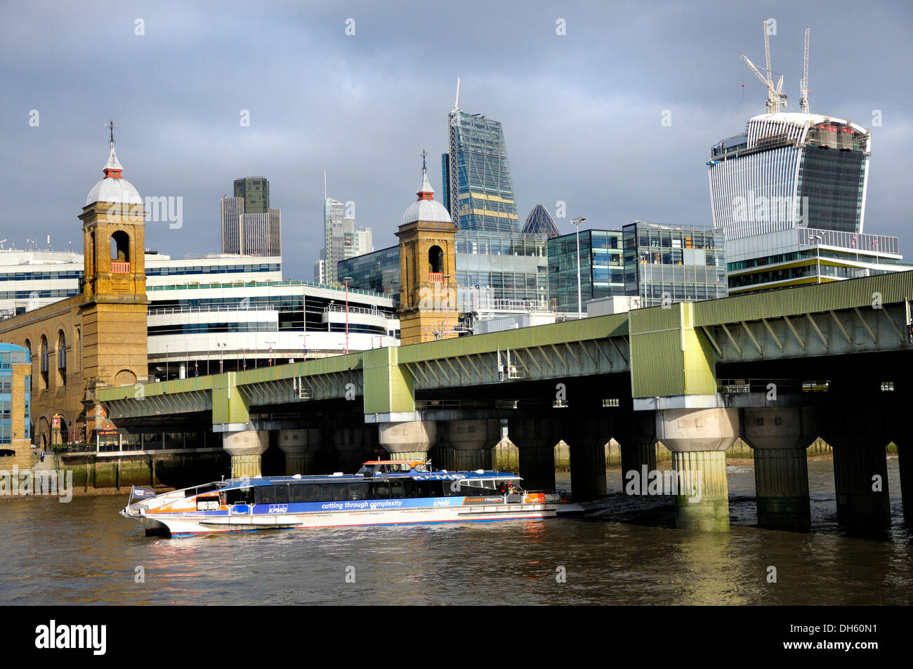 London, England, UK. Cannon Street Station Bridge and the city, seen from the South Bank. 'Thames Clipper' water Stock Photo