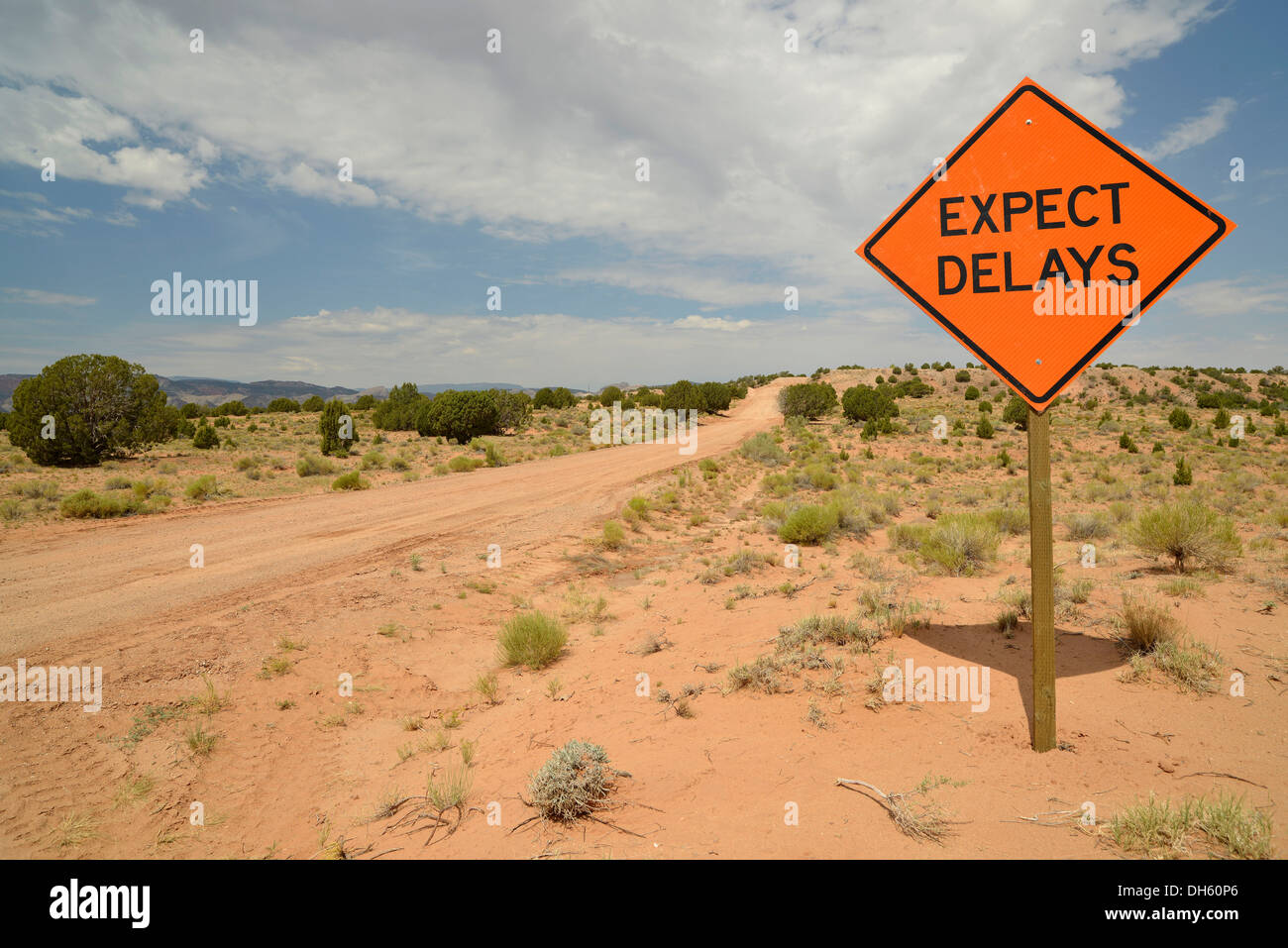 Sign, lettering 'Expect delays', dirt road, Notom-Bullfrog Road, Capitol Reef National Park, Utah, USA - Stock Image