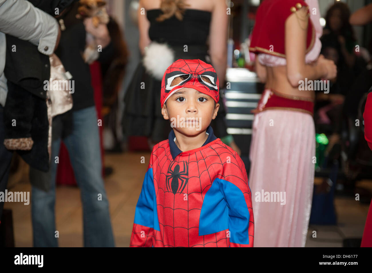 A young, New York City boy dressed as Spider-Man for Halloween. - Stock Image