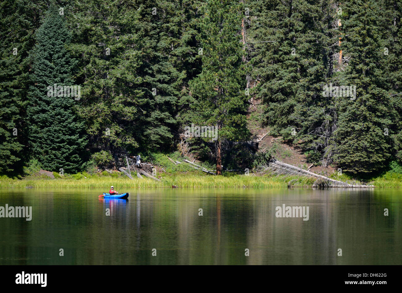 Fishermen in a canoe, Posey Lake, Dixie National Forest, Utah, Southwestern USA, USA - Stock Image