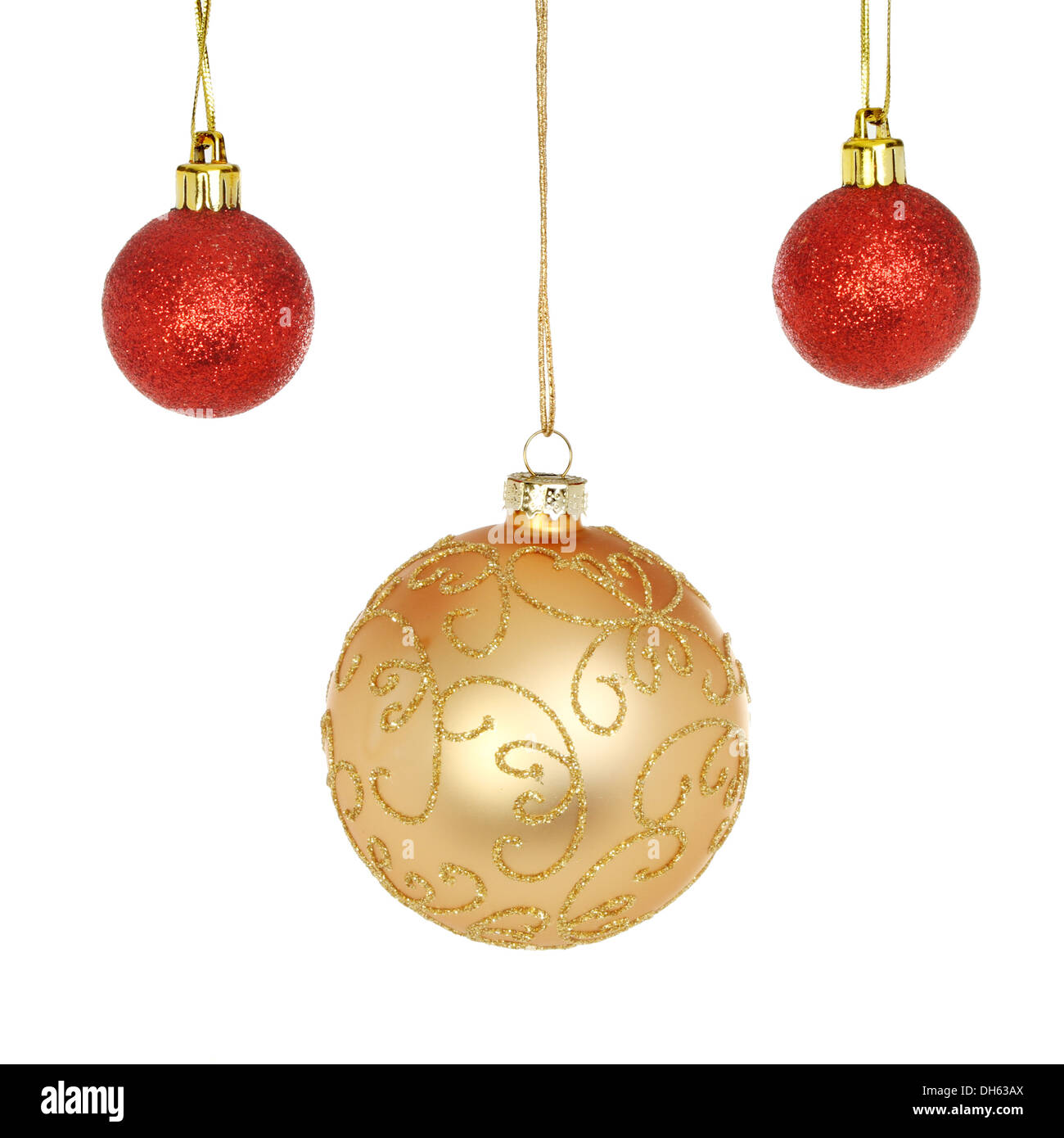 2db799c1c790 Gold and red glitter Christmas baubles isolated against white Stock ...