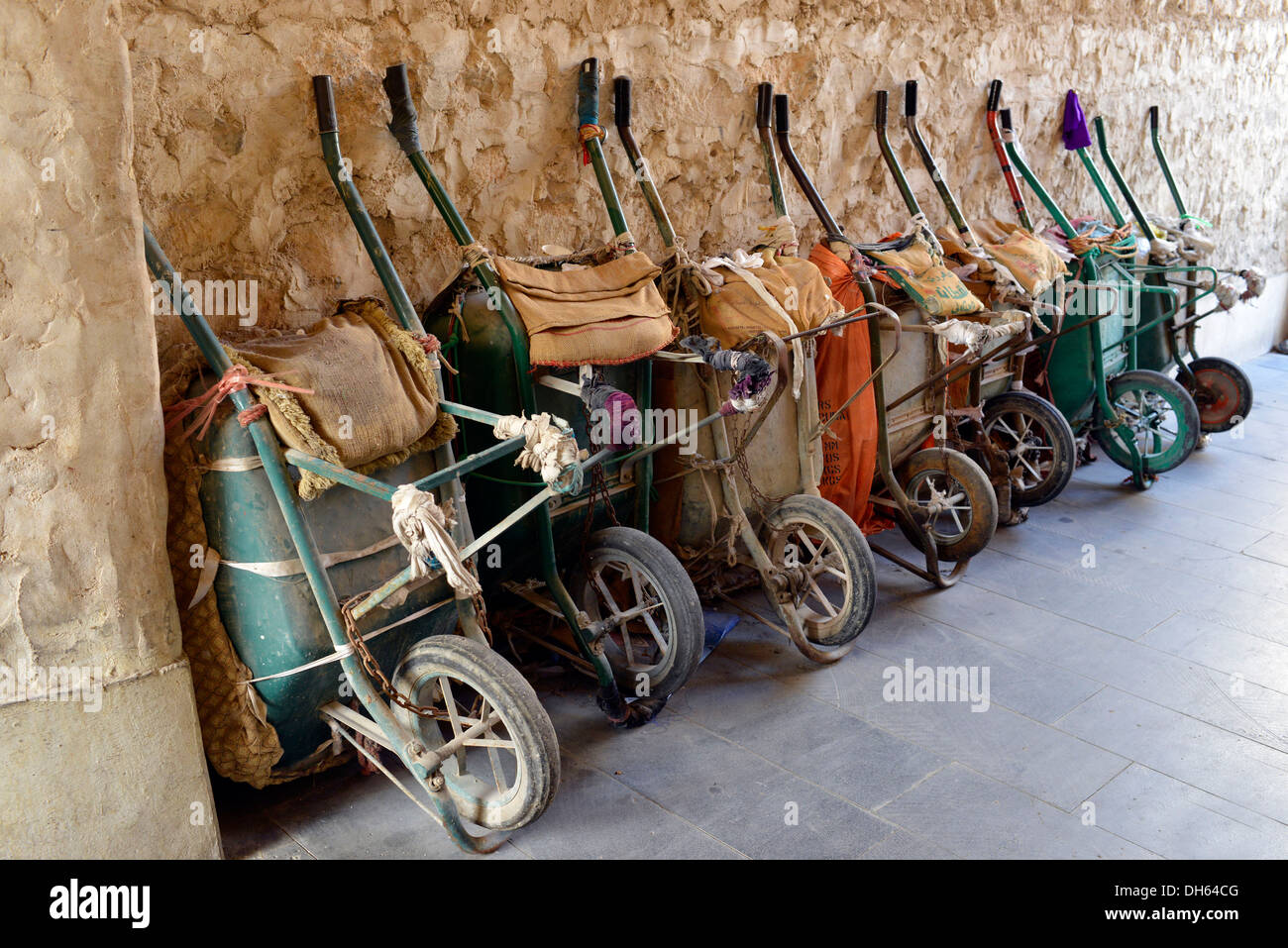 Parking for wheelbarrows, push carts, main means of transport in the Souq al Waqif, oldest souq or bazaar in the country, Doha - Stock Image