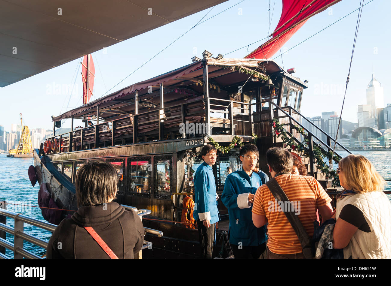 Boarding a traditional junk ship in Hong Kong. - Stock Image