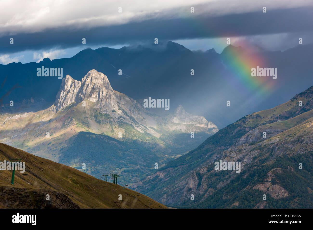 Rainbow over Valle de Tena, Puntal de los petros, Sierra de Tendeñera, Stock Photo