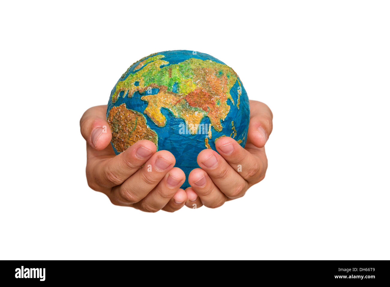Girl's hands are holding a globe, Germany - Stock Image