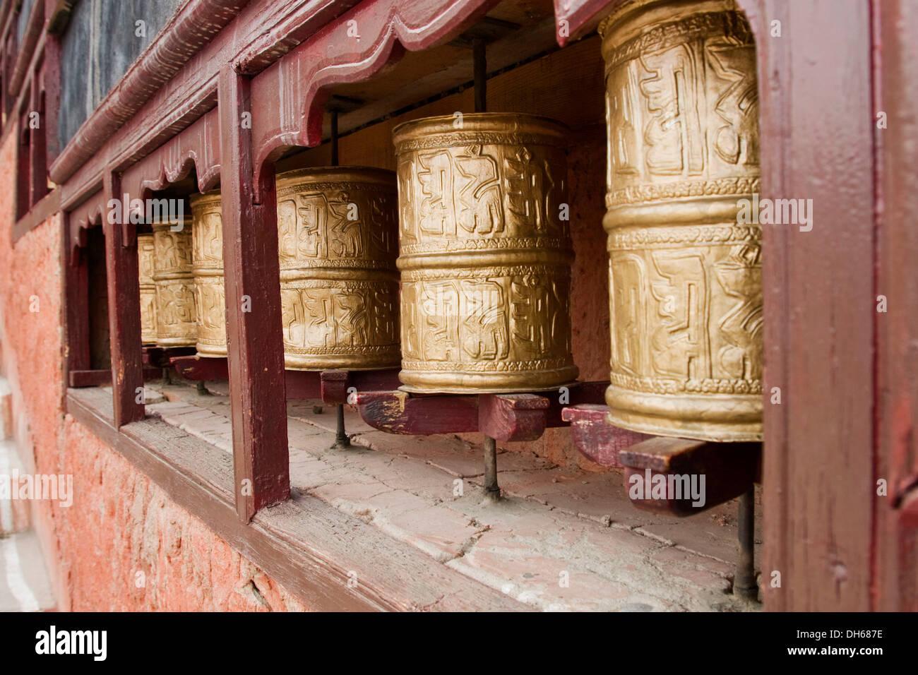Tibetan Buddhist monastery with prayer wheels in the Himalayan region near Leh, Ladakh, Himalaya, India, Asia - Stock Image