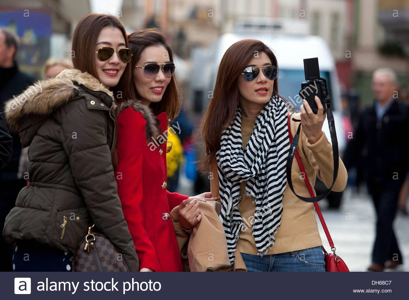 woman-fuckhard-asian-woman-photographing-street