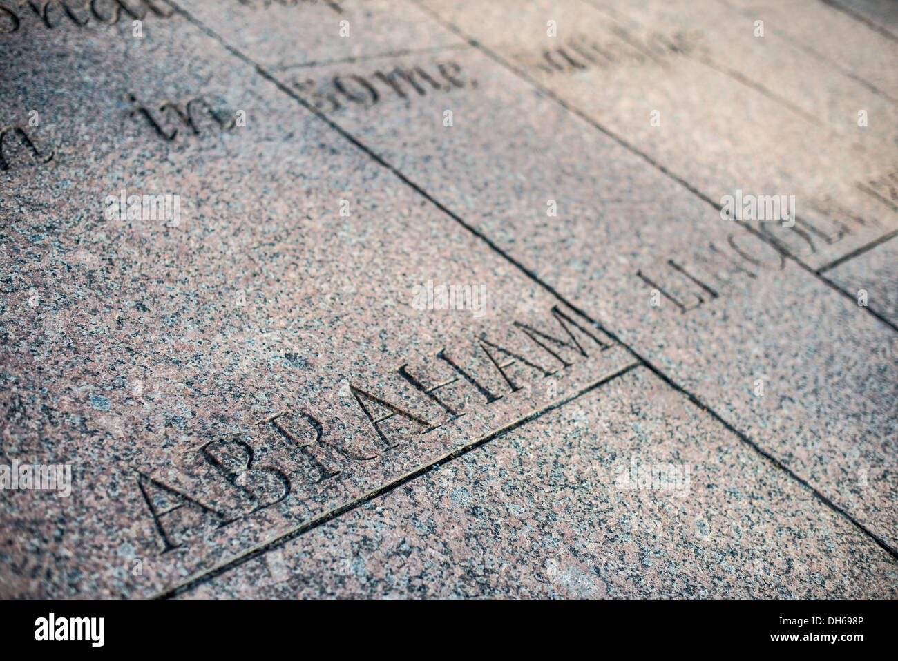 WASHINGTON DC, USA - The inscription of Abraham Lincoln's name beneath a quote by the former president carved into the granite paving at Freedom Plaza on Pennsylvania Avenue in downtown Washington DC. - Stock Image