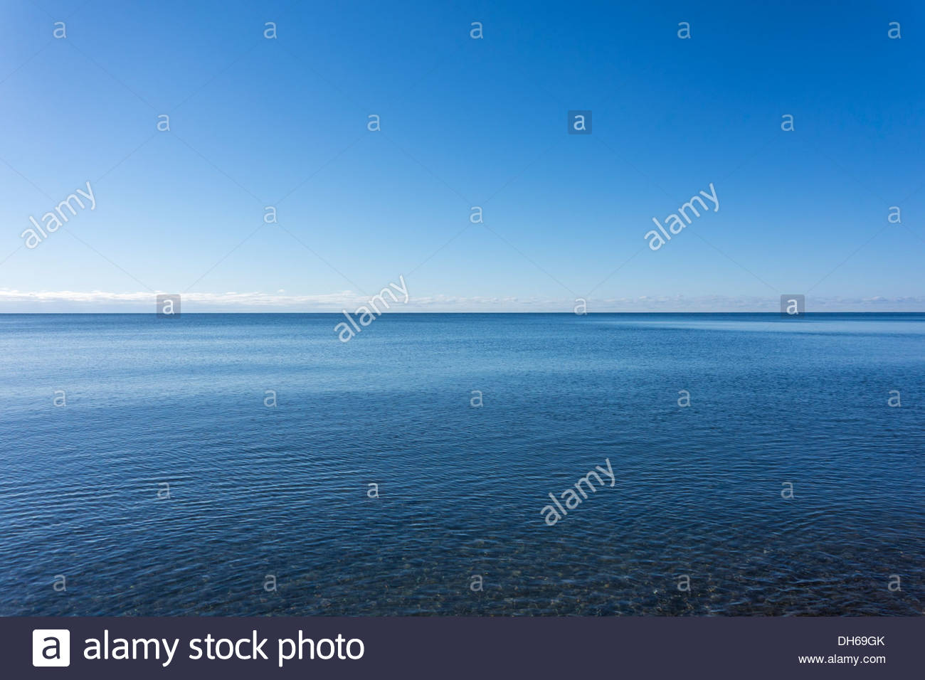 Vast empty infinite horizon of immense Lake Ontario, one of the Great Lakes, at Rouge Beach in Toronto Ontario Canada - Stock Image
