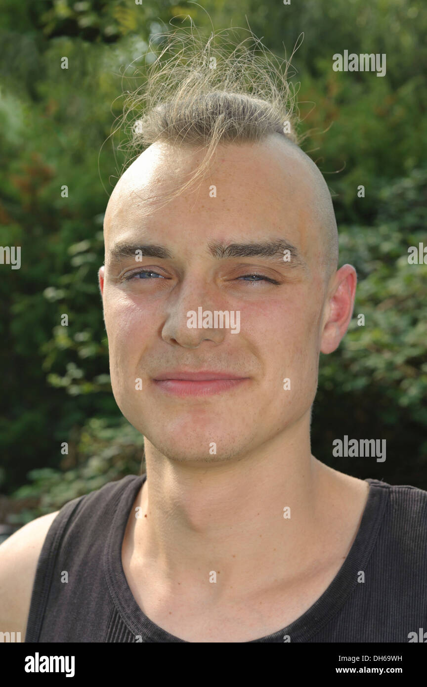 A young man with partly shaved head, dusty from work on a construction site, portrait, Baden-Wuerttemberg, Germany,Europe - Stock Image