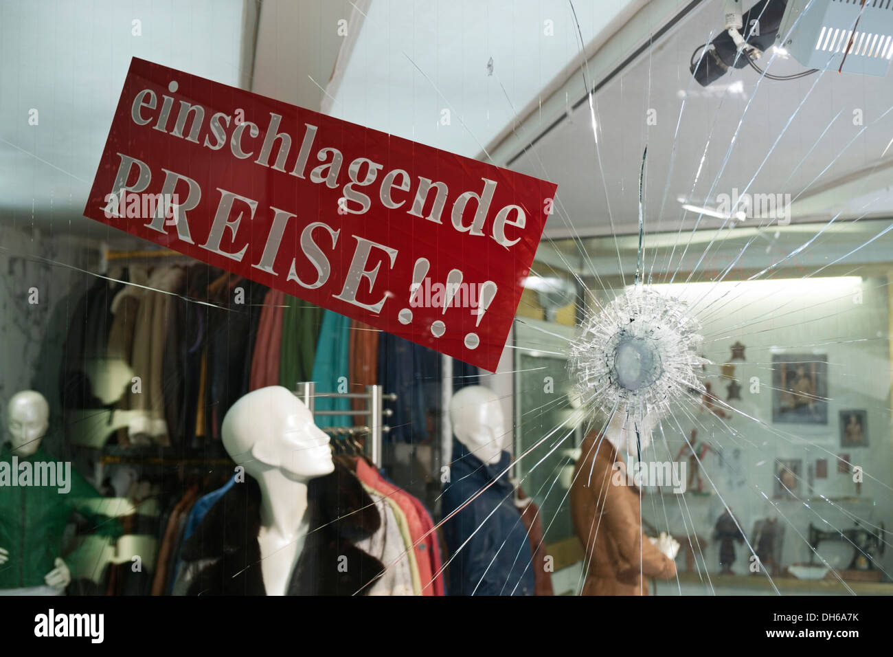 Einschlagende Preise, German for smashing prices, advertising for a fashion store after the shop window made of - Stock Image
