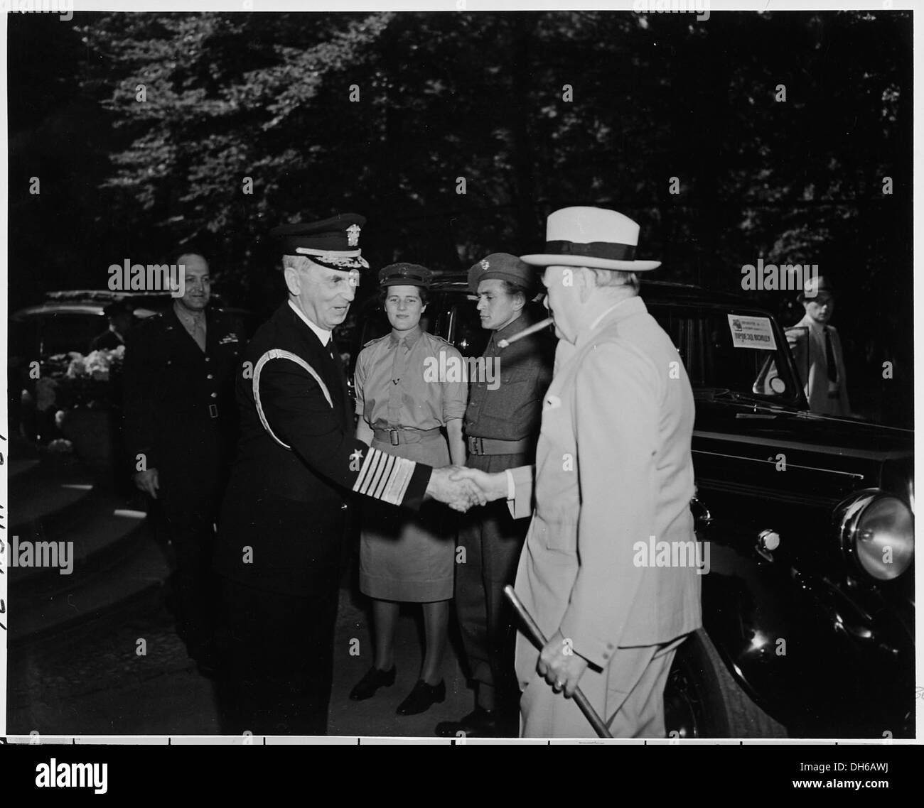 Fleet Admiral William Leahy greets Prime Minister Winston Churchill at the entrance to the Little White House ... Stock Photo