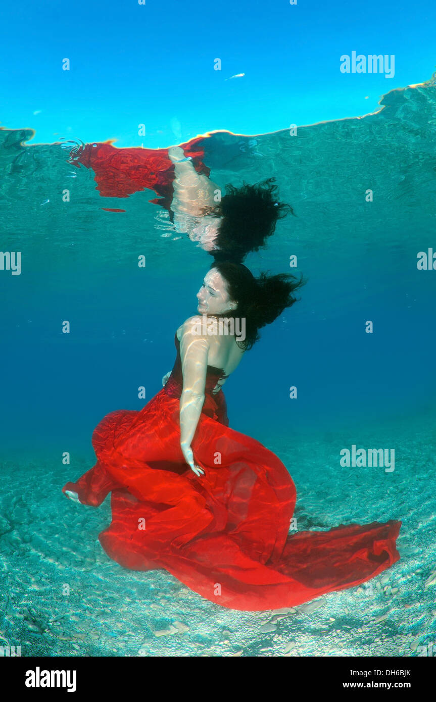 A young woman with big hair posing in Aegean Sea underwater. Greece - Stock Image