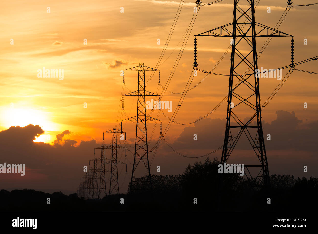 Electricity pylons at sunset, Nr Hinkley Point, Somerset - Stock Image