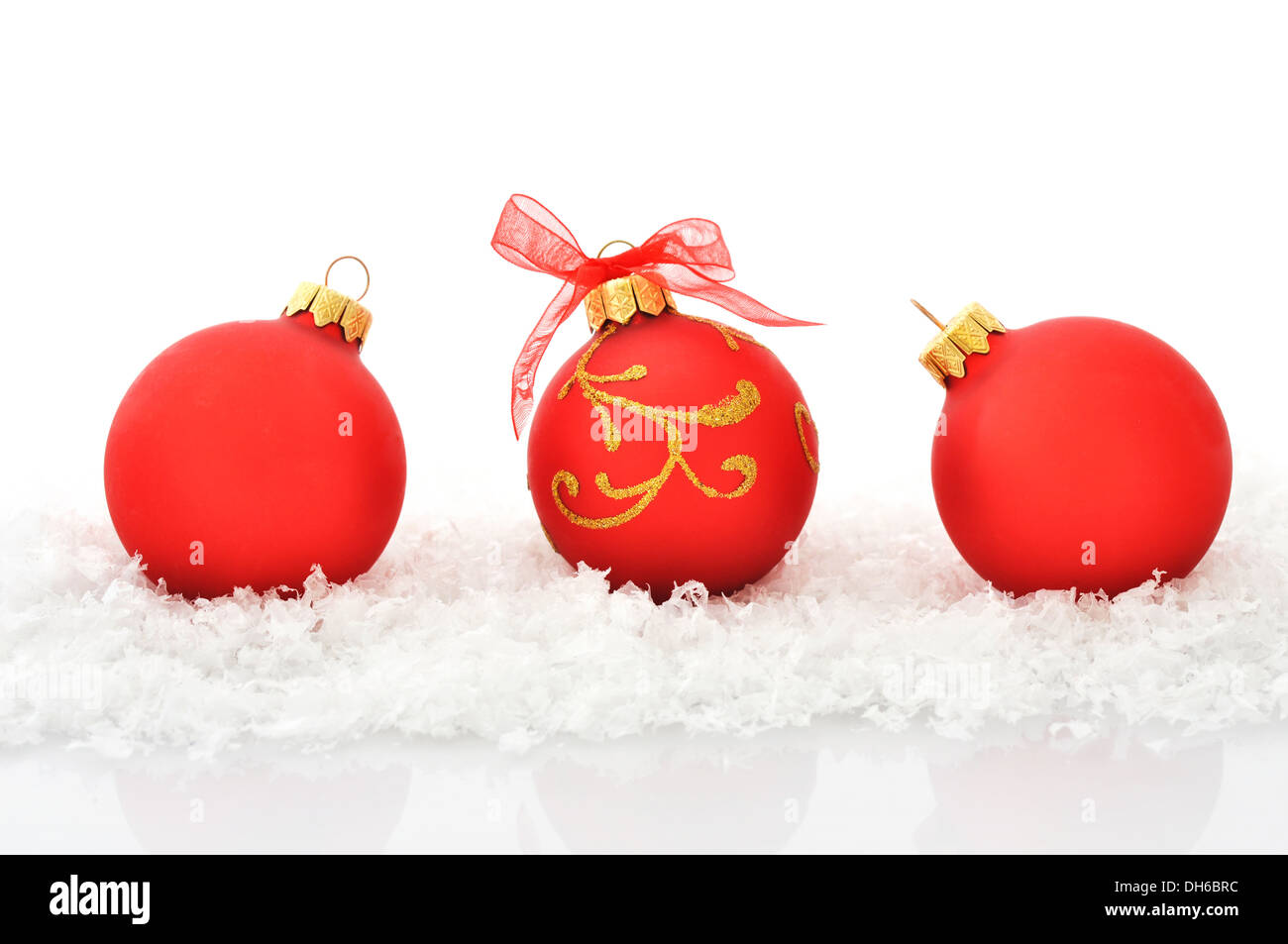 red christmas balls in row and snow isolated on white stock image