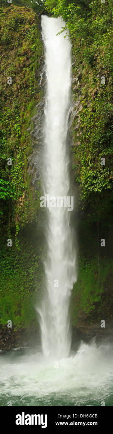 Vertical panoramic image of powerful Catarata La Fortuna (La Fortuna Waterfall) in the rainforest of Costa Rica - Stock Image
