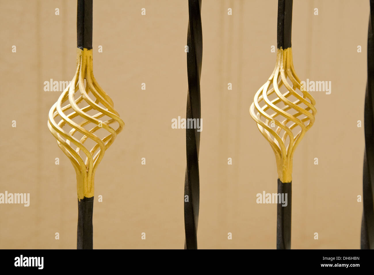 Bulbous design of gold-painted iron barricade rods - Stock Image
