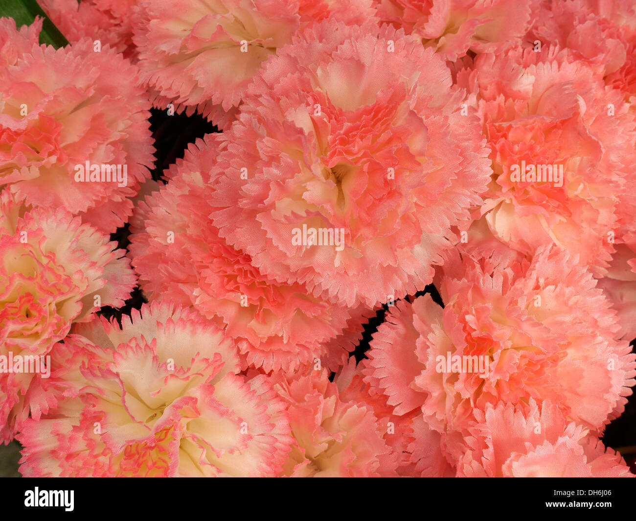 Display of artificial pink Carnation flowers, Gates Garden Centre - Stock Image