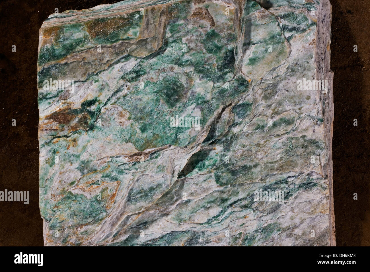 'The Felsite Unit' or green meta rhyolite. Green layering on the rock is a mica called fuchsite and is part of the gold system - Stock Image