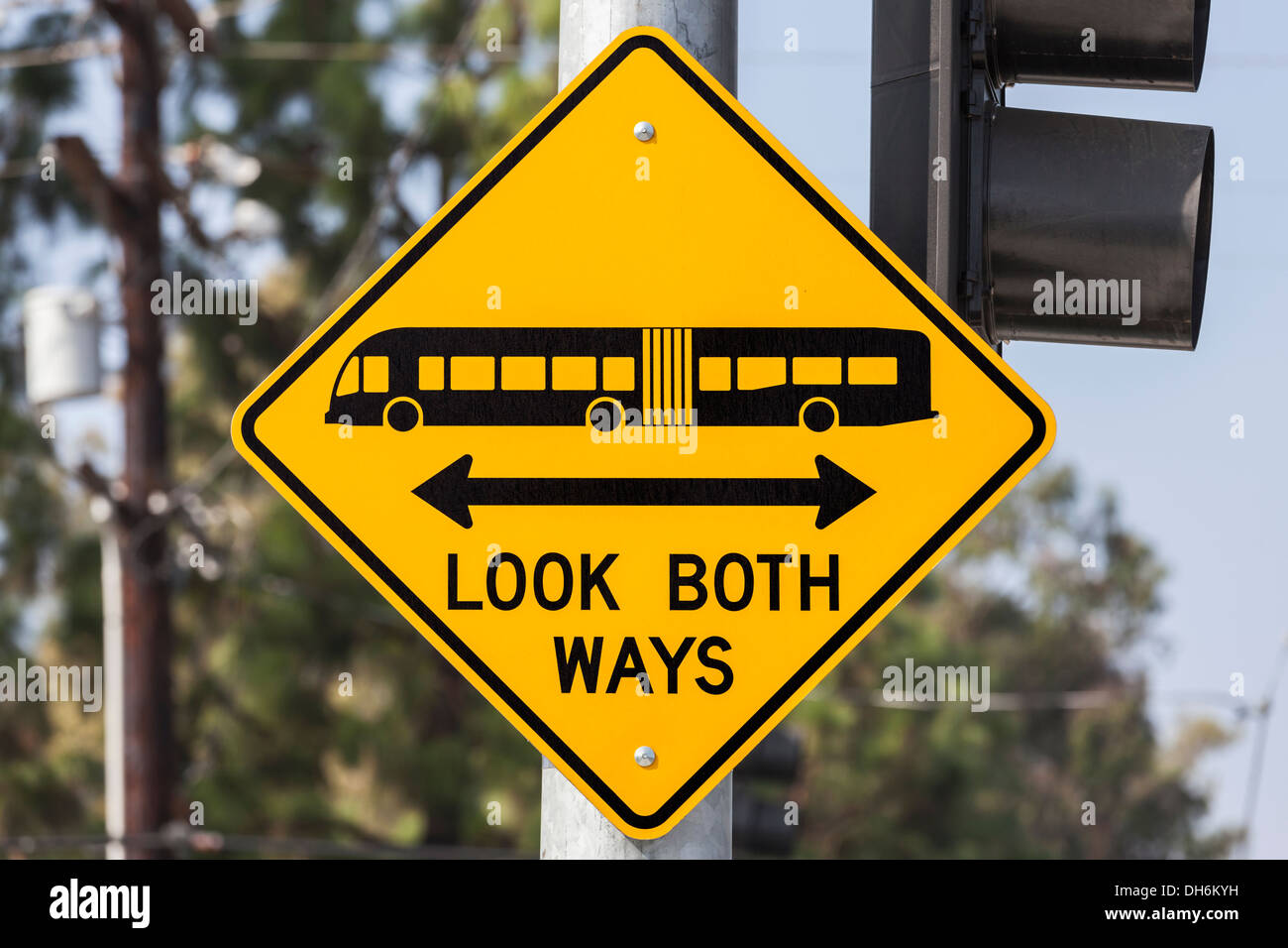 Look both ways bus and tram warning sign. - Stock Image