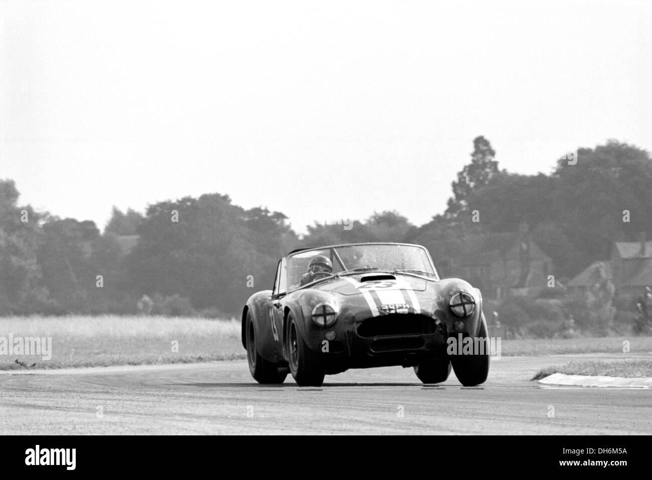 Jack Sears in a Shelby Cobra at St Mary's Corner in the RAC TT race, Goodwood, England 29th August 1964. Stock Photo