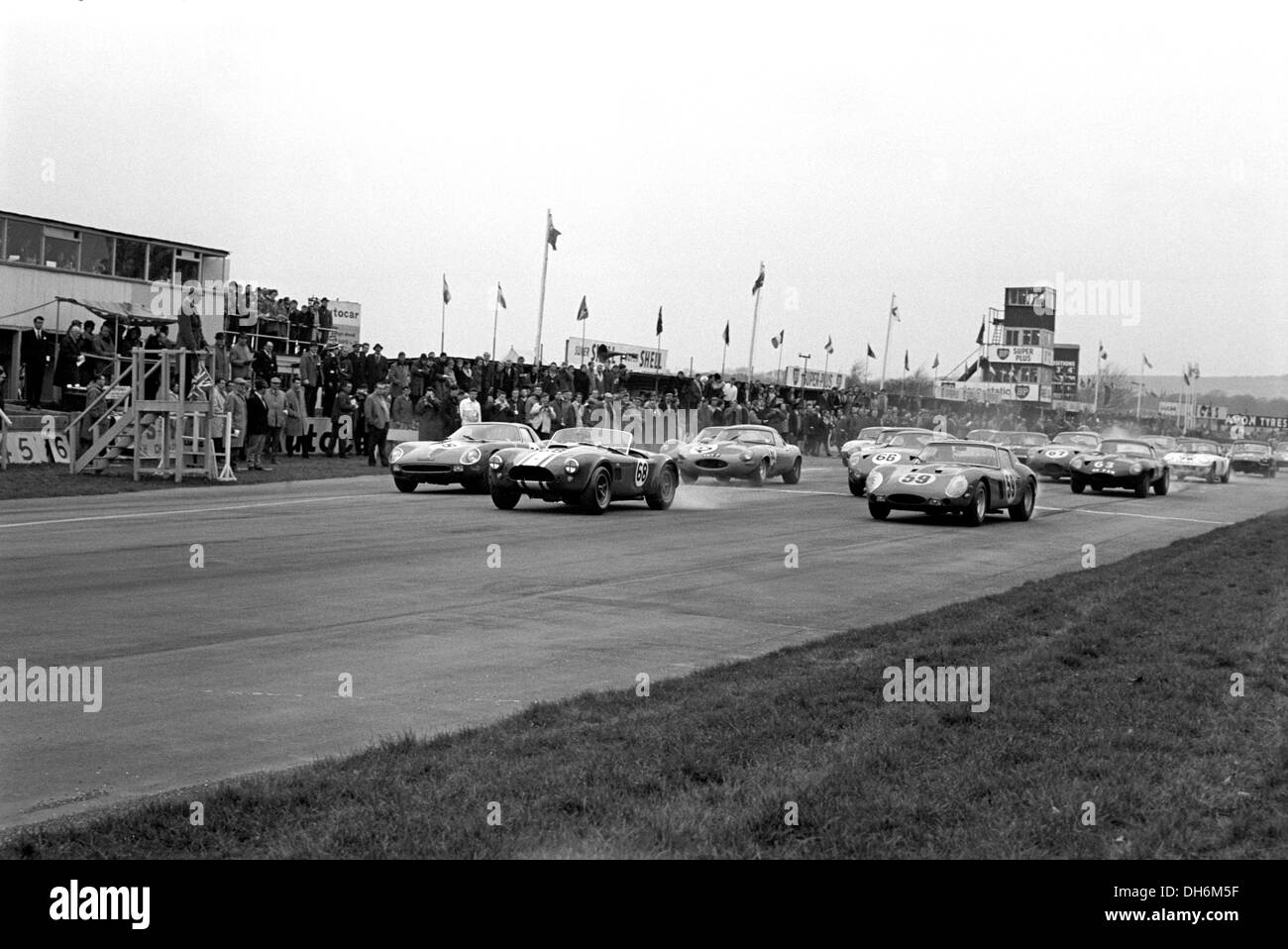 Start RAC Tourist Trophy. No9 Frank Gardner's Elva Mk 7S BMW, No5 John Coundley-Ian Raby - Lotus 19 Climax, Goodwood, 1964. - Stock Image