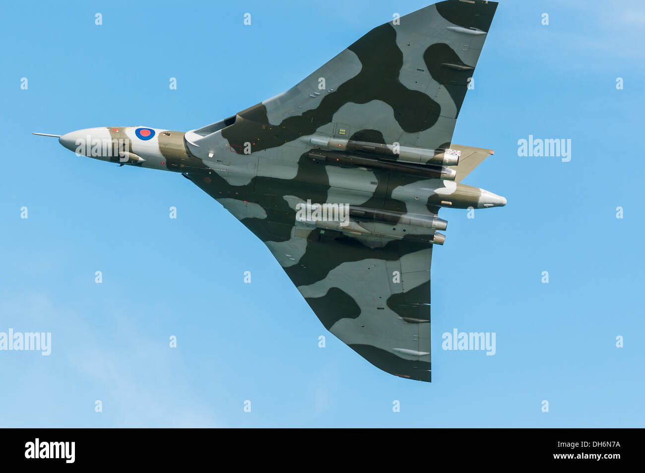 Dawlish, Devon, England. A Vulcan bomber with its bomb bay doors closed in flight over Dawlish during the towns summer air show. - Stock Image