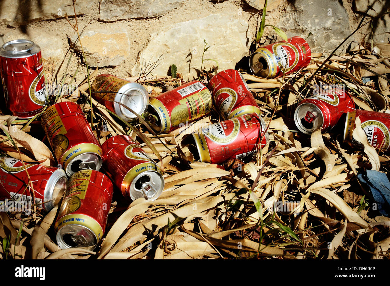 Empty beer cans discarded along the edge of a road on the Greek Island of Skiathos in the Aegean Sea. Stock Photo