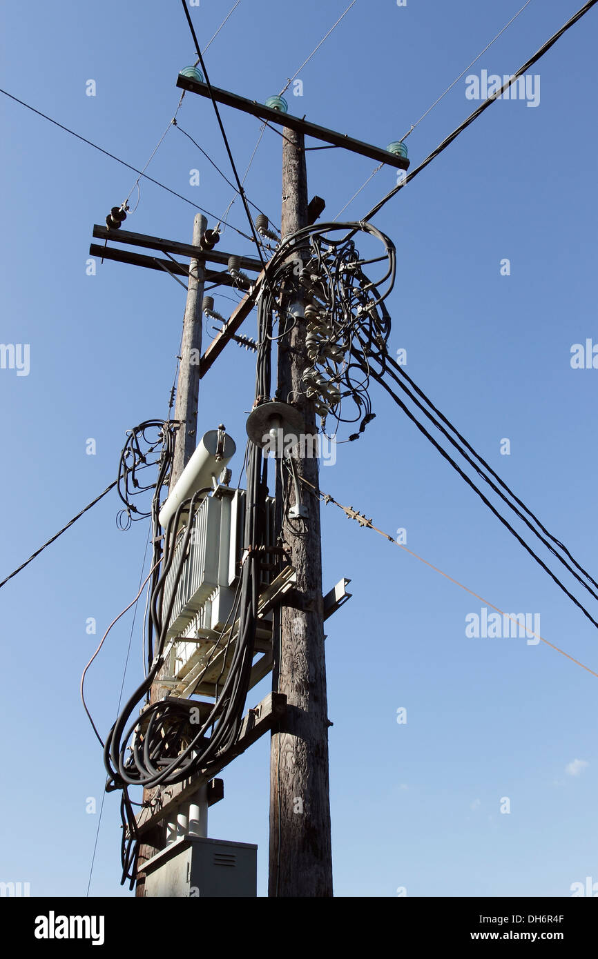 Electrical wiring and sub-station supported on two telegraph poles on the Greek Island of Skiathos in the Aegean Stock Photo