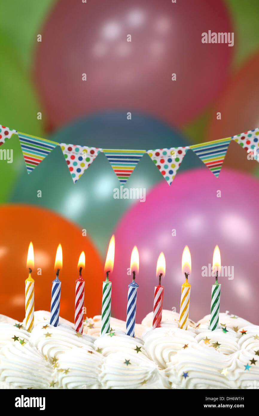 Happy Birthday Celebration with Balloons Candles and Cake - Stock Image
