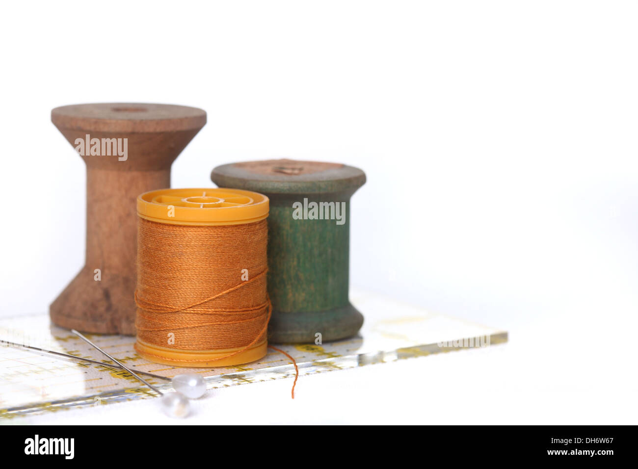 Sewing and Quilting Thread With Notions On White - Stock Image