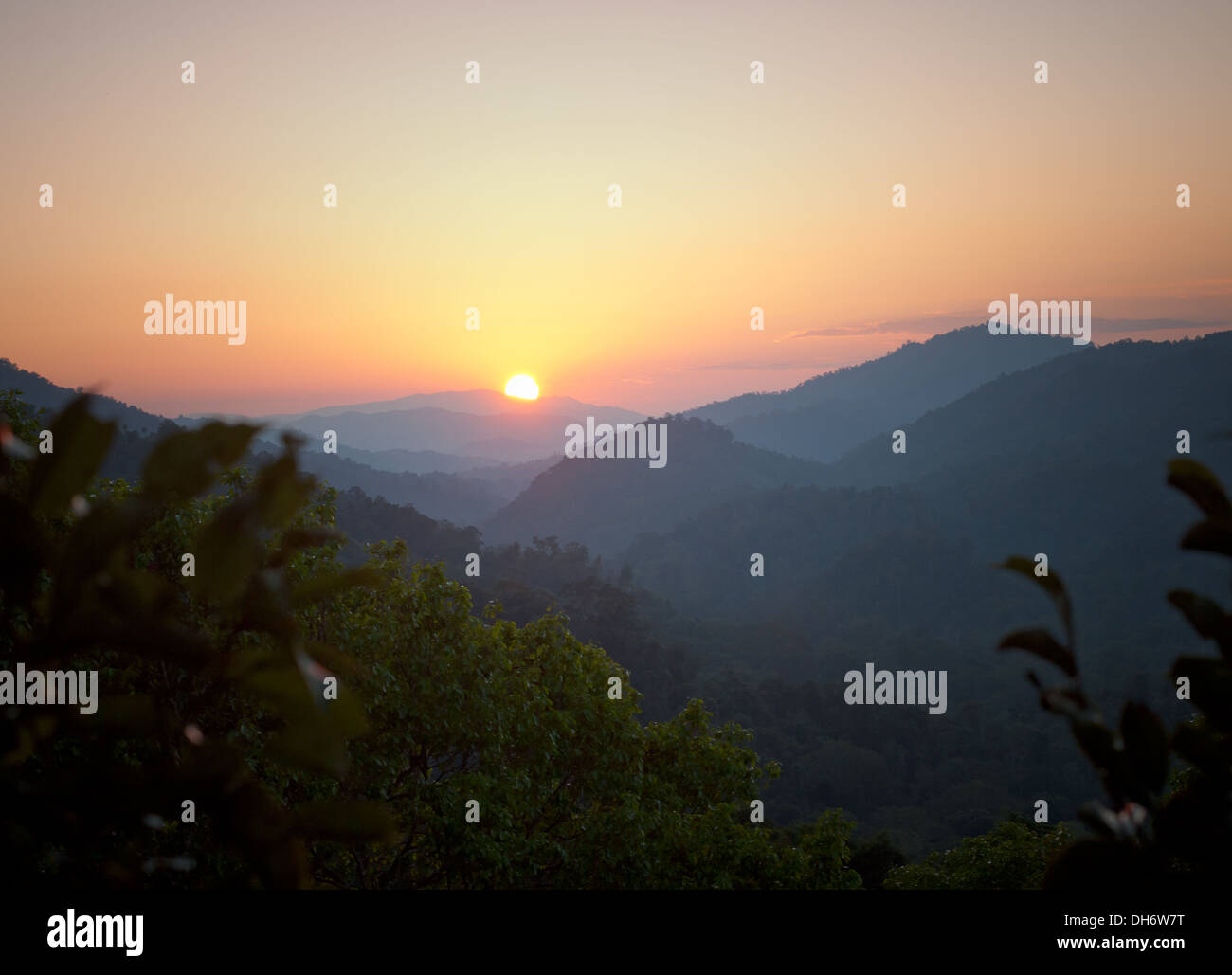 A gorgeous sunset over Bokeo Nature Reserve as seen from a treehouse at The Gibbon Experience near Huay Xai, Laos. - Stock Image