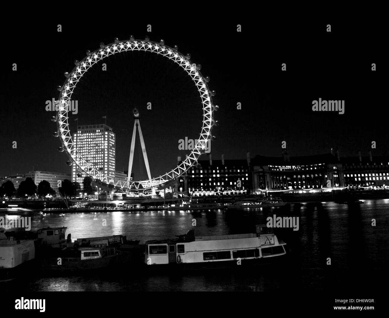 The London Eye and River Thames at night, City of Westminster, London, England, United Kingdom - Stock Image