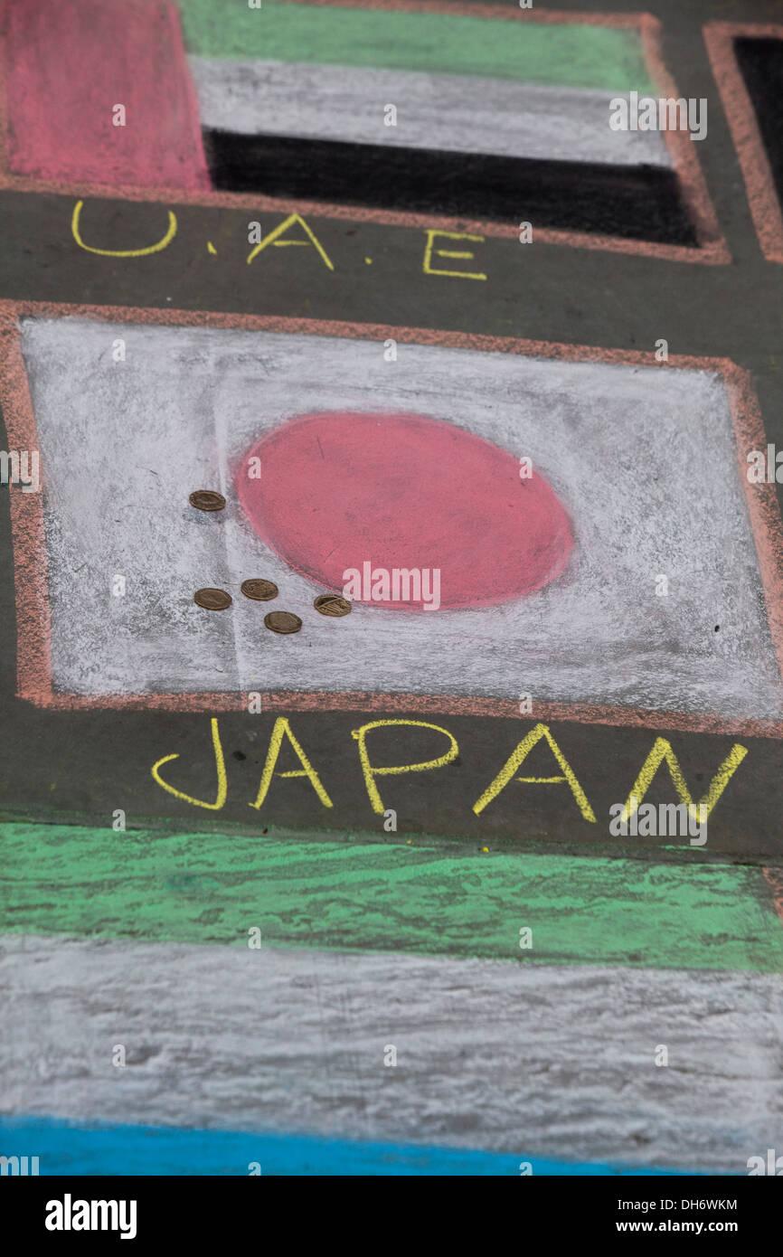 Drawn flags with chalk Trafalgar Square London England - Stock Image