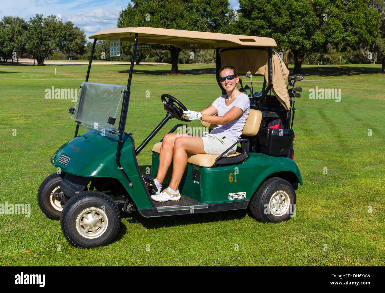 Young woman on a golf cart, Grenelefe Resort, Haines City, Central Florida, USA - Stock Image