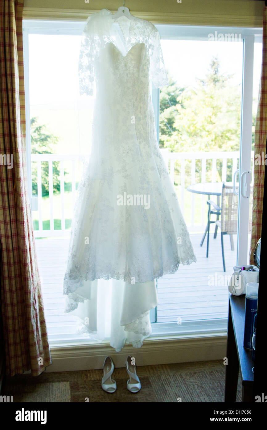 Shot of wedding dress and shoes in the window Stock Photo: 62234068 ...