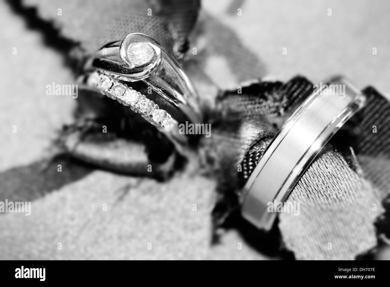 Wedding rings abstract with brown pillow decorated with jewel-black and white photo - Stock Image