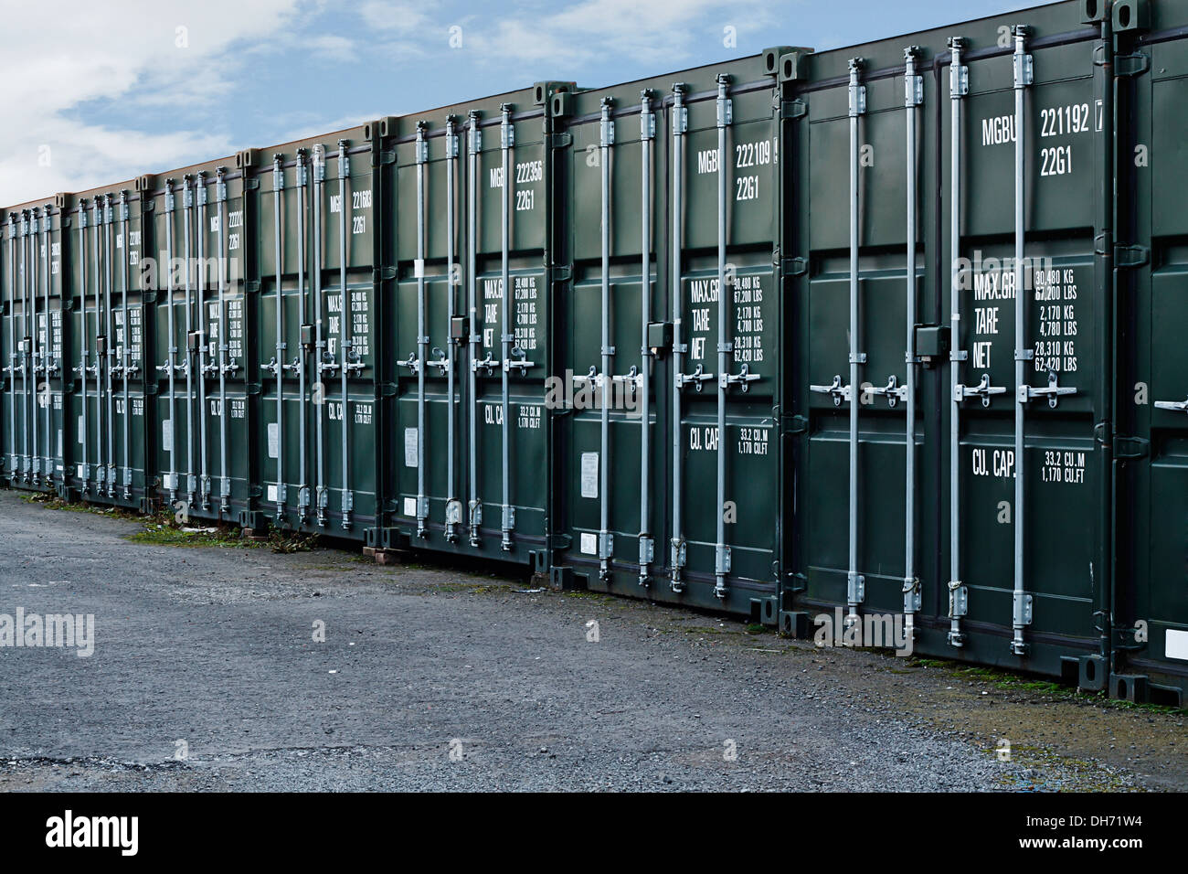 line of new freight containers being used a a self storage solution - Stock Image