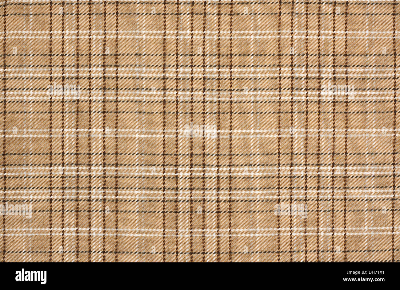 beige tartan background a checked plaid weave pattern with beige, brown, black and white - Stock Image